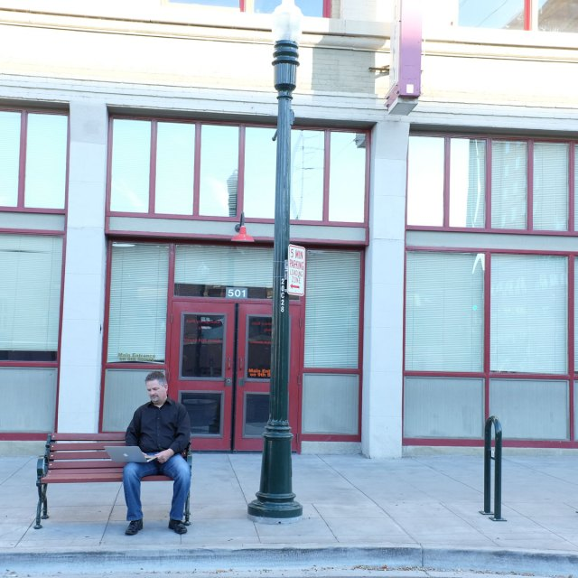 Talloo creator George Seybold working on a bench downtown
