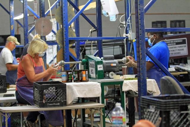 Usful Glassworks volunteer production line