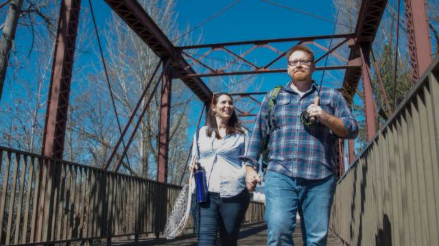 Lone Cone creators Annalisa and Ken crossing bridge in Boise