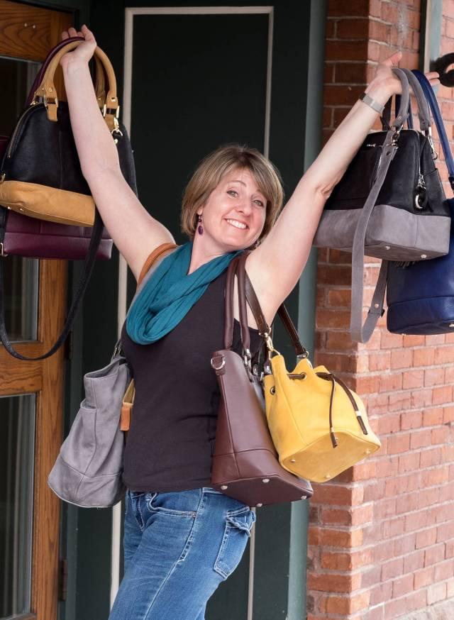Bella Modi founder Kim Mitchell-Catlett carrying purses