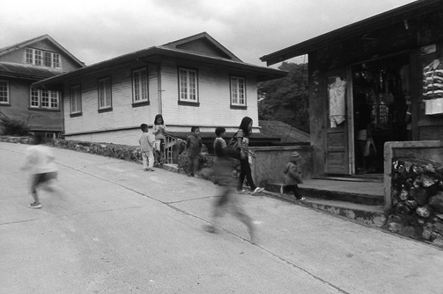 A camera phone's shutter speed and a practiced hand are no match for children bent on playing. (Sagada, Mountain Province)