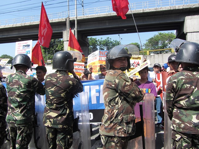 Protesters against US military presence blocked by army and marine soldiers in front  of Camp Aguinaldo (Bulatlat File Photo 2013)