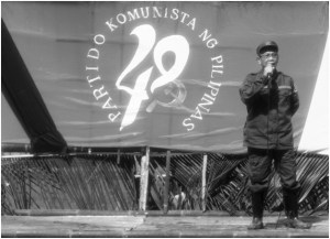Jaime 'Ka Diego' Padilla, spokesperson of MGC, addresses the crowd. Ka Diego said the communist rebellion in the Southern Tagalog continue to gain strength as more recruits mostly from the peasant and youth sectors joins the NPA. (Bulatlat photo)