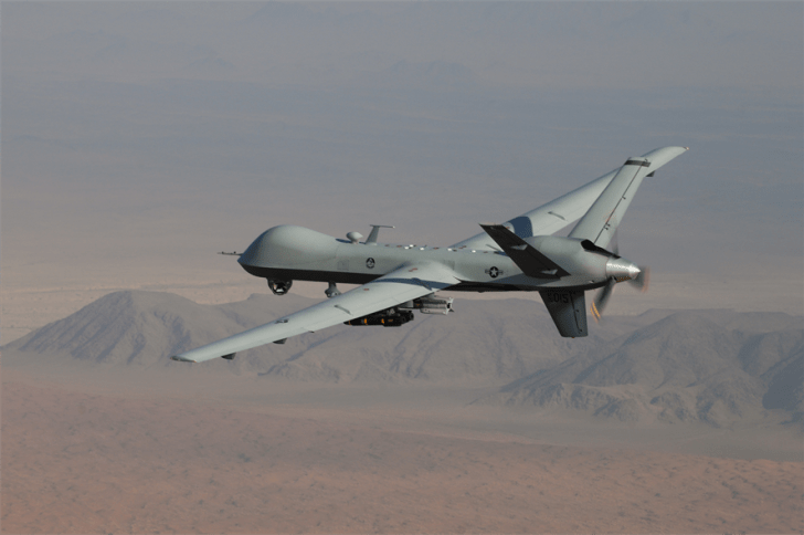 An MQ-9 Reaper, armed with GBU-12 Paveway II laser guided munitions and AGM-114 Hellfire missiles, flies a combat mission over southern Afghanistan. (Photo by Lt. Col. Leslie Pratt/U.S. Air Force website)