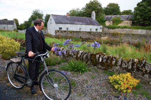 "William Bulfin was a man who loved everything about Ireland; its heritage, its landscape, its people. Nowhere was this more evident than in his writings, as he travelled around this beautiful land of ours on his High Nelly bicycle in 1902. For him all Ireland was sacred ground, but in a particular way his heart was in North Munster and the soft melancholy Midlands, and it was in those places that his book of journeys began. In his book, ""Rambles in Eirinn"" William wrote ...""You are higher than the grey peaks of the nearest ranges; you are on a level with the others. You are up in the blue air where only the eagle soars and the skylark sings.The rooks and daws and seafowl are winging their flight below you over lake and valley and hill. Only the clouds lie here when they are lazy or too full of rain to travel. It is the flower of bogs-the canavaun of the mountain tops of Eire."" From everything that that passage meant to the soul of the man who wrote it. The ingredients of that passage are an eye for colour, a remembrance of things past, an ability to see and value the phenomena of social change. Benedict Kiely from ""The Capuchin Annual"" 1948"
