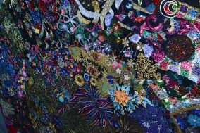 Art made from bedazzled sweatshirts which cracks me up because I can think of all the women who once wore them
