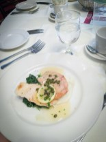 Petterino's Chicken Limone with sautéed spinach, capers