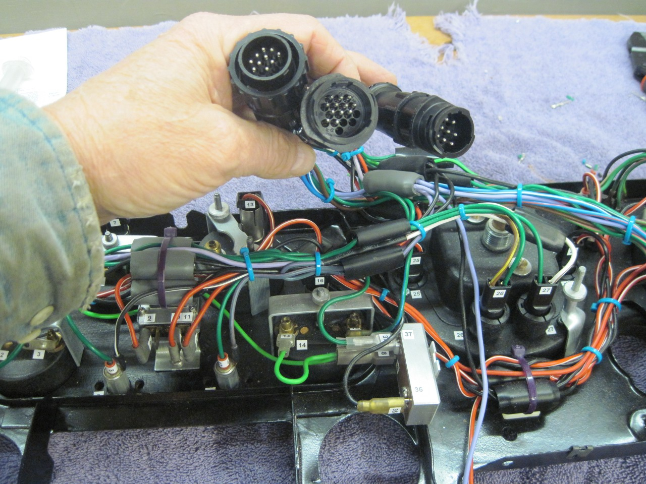 hight resolution of then terminated all the wires going elsewhere into three circular connectors one each for the cables going to the new power module the front of the car