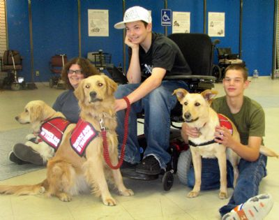 Participating in BARK program are (from left) Holly with her trainer Amanda, Maple with trainer Matt, and Daisy with trainer Sean.
