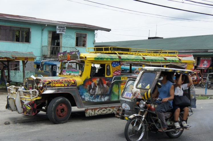 Jeepney and tricycle in Gubat town main thoroughfare