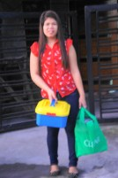 Jomabel with containers full of mamon off to church for the Candelaria mass.