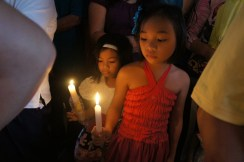 Little girls with their candles ready for blessing.