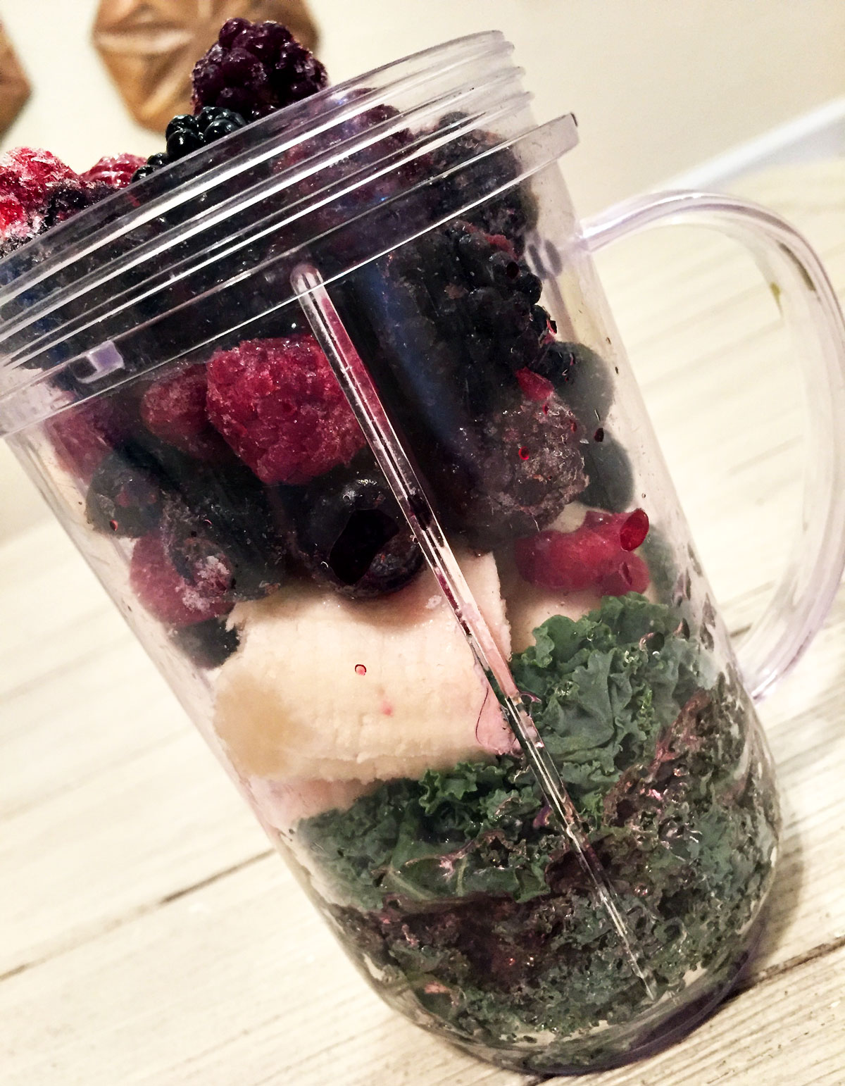 Five-Healthy-Foods-That-Are-Always-In-My-Kitchen-Berry-Kale-Smoothie-By-Bumble-and-Bustle