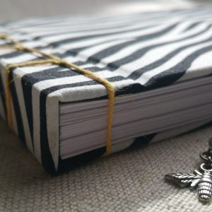 A zebra-print notebook with yellow detailing