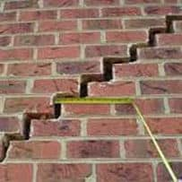 image of large crack in an exterior brick wall