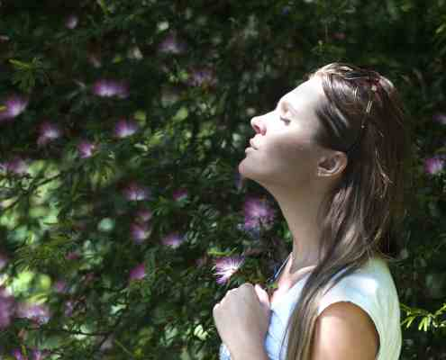 woman breathing in fresh air