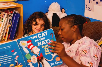 Early Educator and Child Reading Cat in the Hat