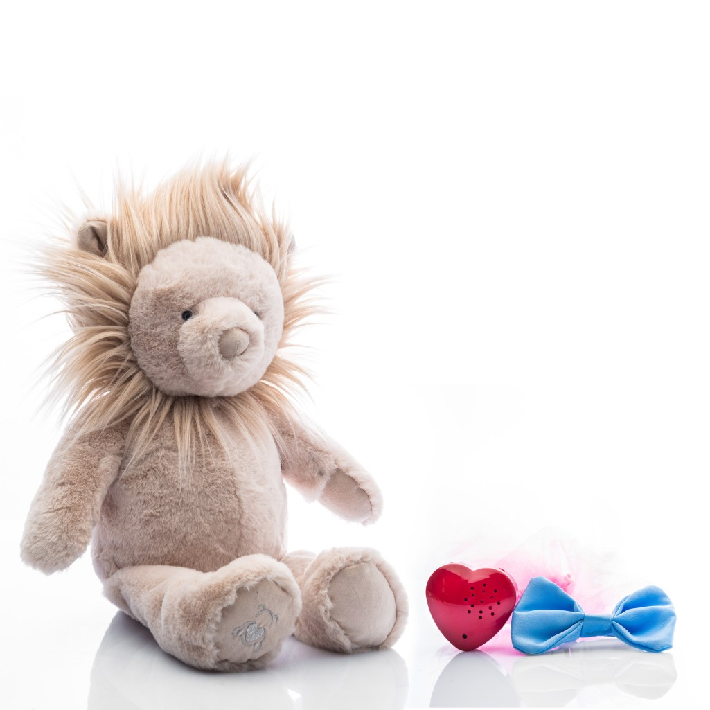 Baby Beats plush lion toy with tutu and bowtie