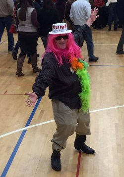 Donald Trump supporter Dean Blake rocks a pink wig and a feather boa to Friday night's campaign rally at Tyngsborough Elementary School. (Andrea Asuaje/BU News Service)