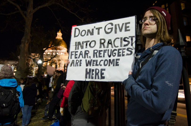 BOSTON, 20th Nov 2015: Locals rallied against Governor Baker's position on Syrian refugees outside the Massachsetts State House on the Boston Common Friday. (Photo by: Nikita Sampath)