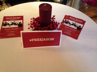 A sign with the hashtag #FreeJason in support of imprisoned journalist Jason Rezaian at the Hugo Shong Reporting in Asia Award reception.
