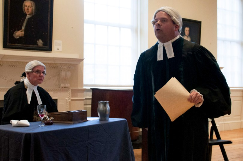 """BOSTON, March 5th, 2016: Ed Hurley (L) and Mike LePage (R) play the roles of the prosecutor and the lawyer, John Adams, in the interactive play """"Trial of the Century"""". The play is a part of the Old State House's program in commemoration of the Boston Massacre. (Marwa Morgan/BUNS)"""