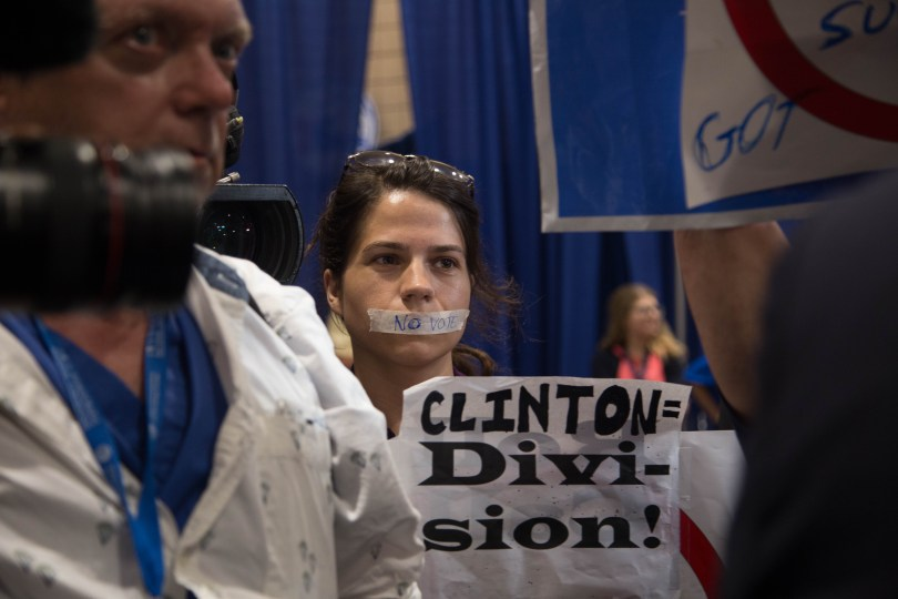 A protestor with her lips tape in protest of the nomination of Hillary Clinton isnide the Wells Fargo Arena in Philadelphia on Tuesday. Photo by Pankaj Khadka