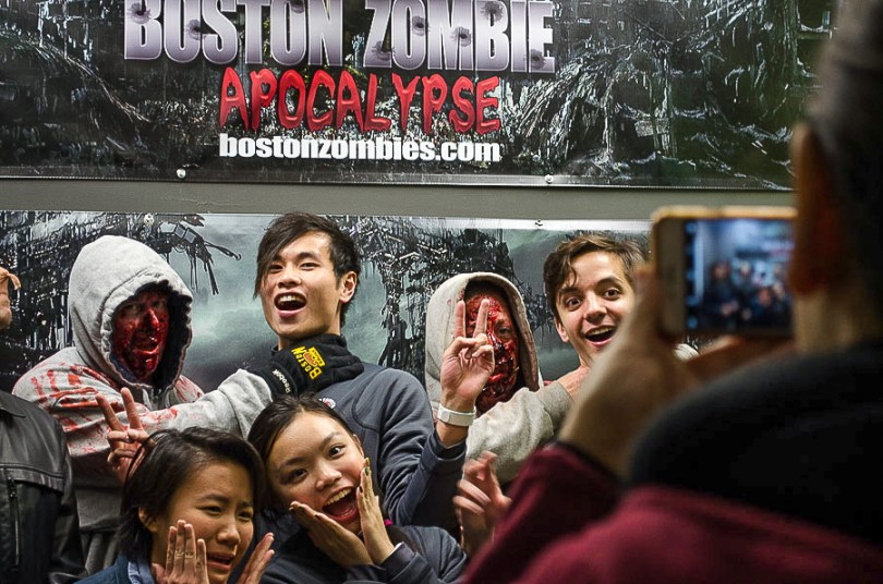 Participants take a photo with volunteer zombies Saturday night at Stronghold Ops Airsoft, which converts its Abington, Mass. headquarters into a post-apocolyptic site during October. Photo by Crystal Milner/BU News Service