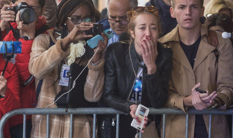 A Hillary Clinton supporter gets emotional after watching Clinton enter the New Yorker Hotel to make her concession speech Wednesday morning. Photo by Alexandra Wimley/BU News Service