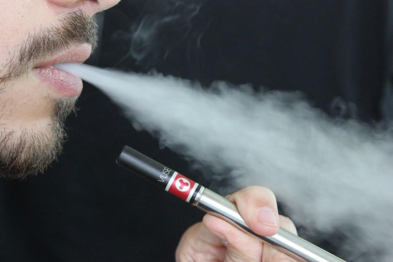 Man smokes an e-cigarette