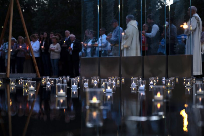 People gathered at the Massachusetts Fallen Heroes Memorial
