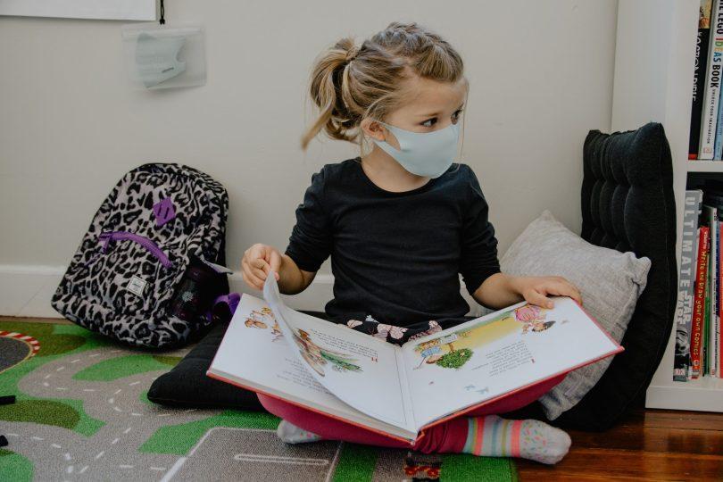 A kid wearing a mask