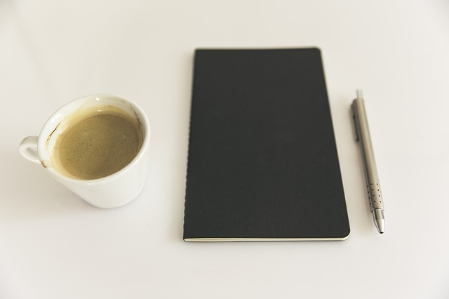 how-to-learn-spanish-in-a-month-pen-notebook-coffee