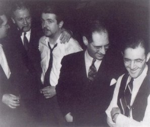 At the Metronome All-Star recording session, January 12, 1939, NYC; L-R: Tommy Dorsey and his manager, Bobby Burns; Berigan; Metronome chief writer and editor, George T. Simon; Benny Goodman.