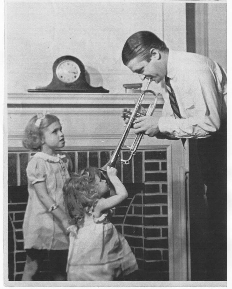 Bunny with his two daughters in July, 1939, at the Schlitzberg-Berigan house, Fox Lake, WI. Patricia is age 7; Joyce 3.