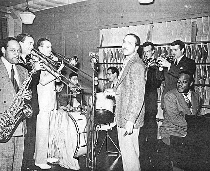An on-air jam session from the studios of WNEW-New York, June 14, 1940. L-R: Coleman Hawkins; Jack Jenney; Tommy Dorsey; unknown technician; Gene Krupa; Martin Block of WNEW; Harry James; Berigan and Count Basie.