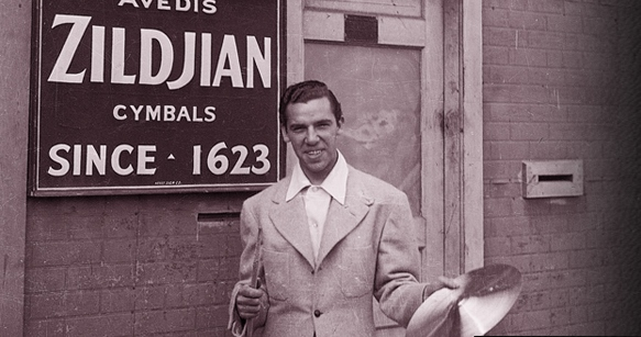 """Drum legend Buddy Rich outside of the Avedis Zildjian cymbal factory in Quincy Massachusetts, September 20, 1938. The night before, as a member of Bunny Berigan's band, he played the opening of a prestigious two-week engagement at the roof garden of Boston's Ritz Carleton Hotel. The next night, the great hurricane of 1938 struck Boston and blew the Berigan band out of work for several days. Rich once told me: """"playing with Bunny Berigan's band was my first big-time jazz gig. He was a hell of a musician, and his band was one of the best in the business then."""""""