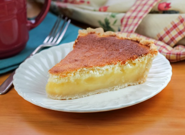 This Lemon Sponge Pie is an easy pie recipe with refreshing lemon flavor and light and airy texture. It makes a deliciously light treat.
