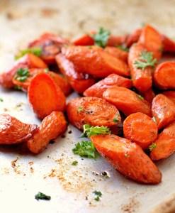 diagonally cut roasted carrots on a baking sheet