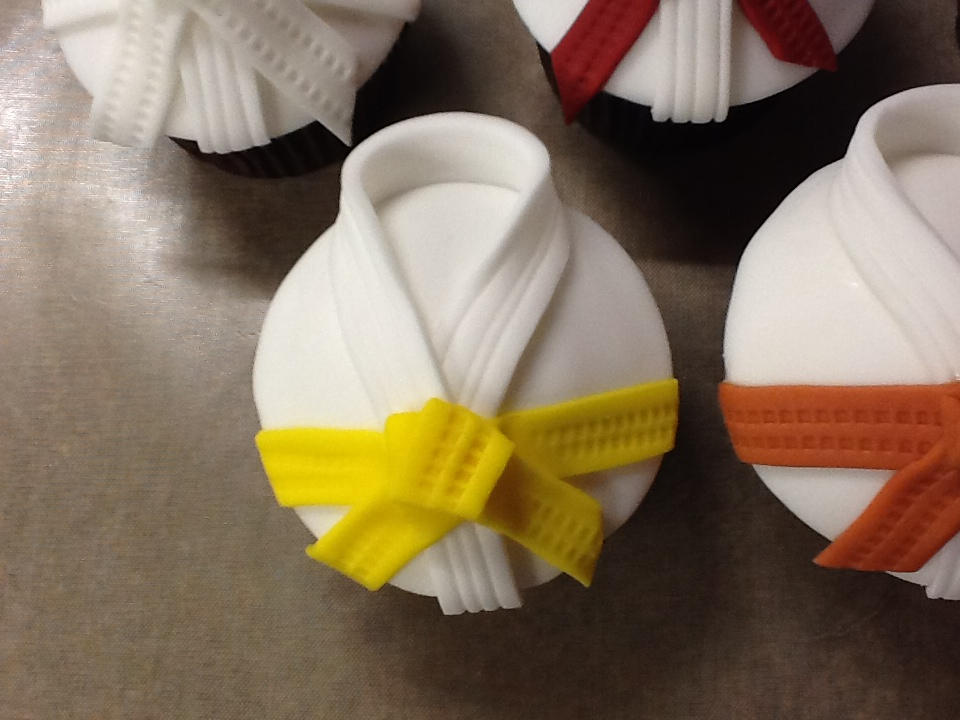 A Black Belt In Cake Decorating? Buns On Seats!