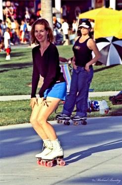 Roller Skaters, Skate Dancing plaza, Ocean Front Walk promenade (Boardwalk), Venice Beach, Los Angeles, California. Fujifilm RHP III Provia 400 35 mm Positive slide film cross-processed.