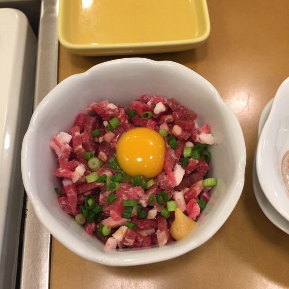 Sakura Natto: Chopped raw horse with natto and egg yolk
