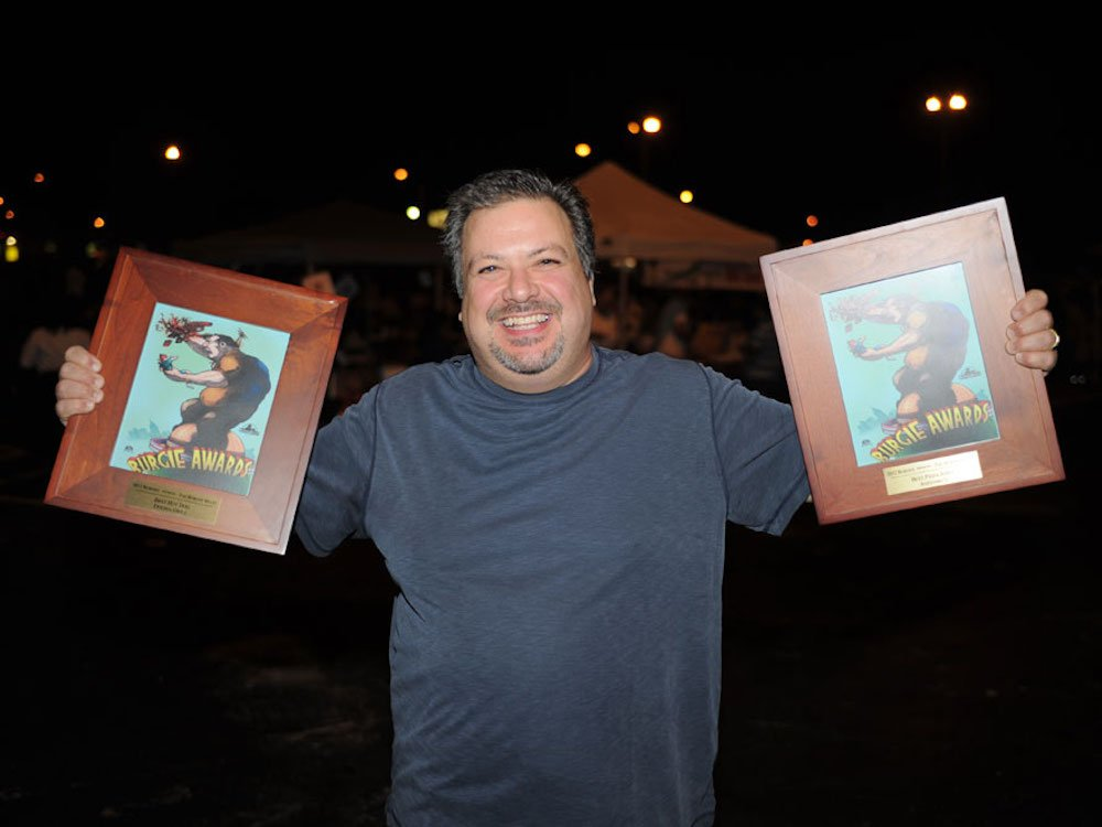Co-owner Frankie Cupri with Andiamo's 2011 Burger Beast Burgie Award