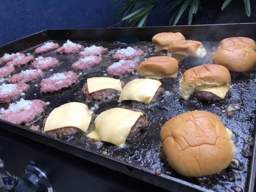 Burgers cooking on a Blackstone Grill