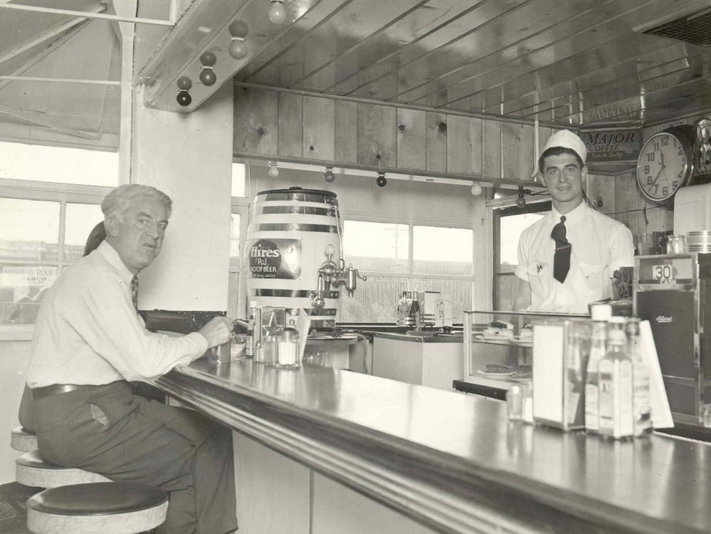 Bob Wian serving a customer at Bob's Pantry in 1936