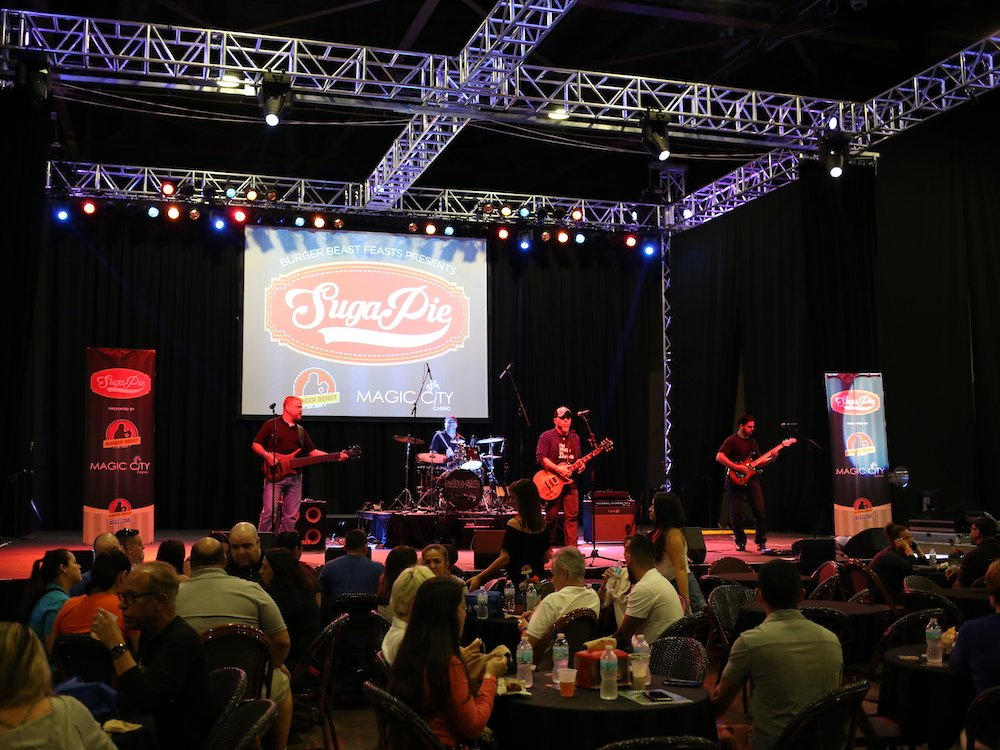 Band performing live on the stage at SugaPie event