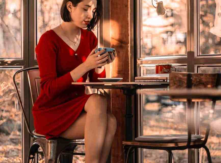 woman wearing red long sleeved dress