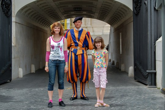 With a Vatican guard