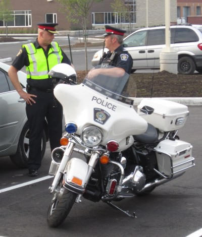 Halton Regional Police Chief Stephen Tanner talks with Sgt Davies, the man who heads up the accident reconstruction unit. The two of them would really like to see fewer accidents.