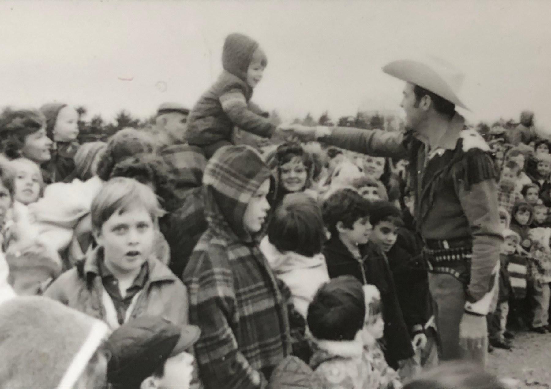 Rex Trailer shakes child's hand